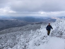 Robin rounds the bend just before the summit of Camel's Hump yesterday!