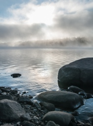 Morning fog burning off Indian Lake in the Adirondacks.