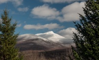 Camel's Hump glows with a mantle of snow and rime yesterday at midday.