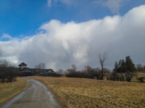 Snow squall clouds pass to the north and east of the Breeding Barn at Shelburne Farms yesterday at midday.