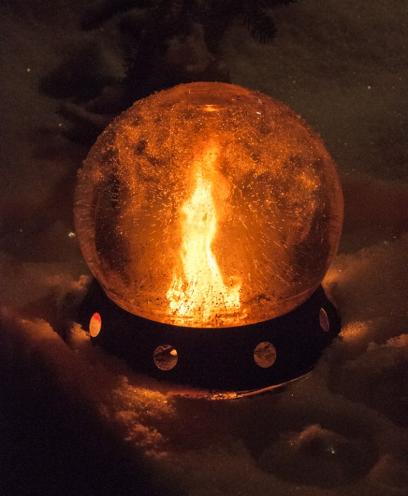 Robin made this cool ice globe and kindled a small fire inside. Quite lovely!