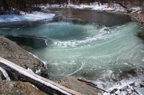 Swirling currents crystalized in green ice at Horseshoe Bend on the Huntington River yesterday morning.