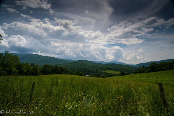 Cumulus congestus clouds build up in the midday sky over the Green Mountains in this view from the top of Taft Hill.