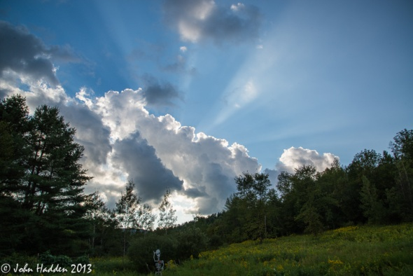 Crepuscular rays stream from backlit cumulus clouds  above our front field yesterday afternoon