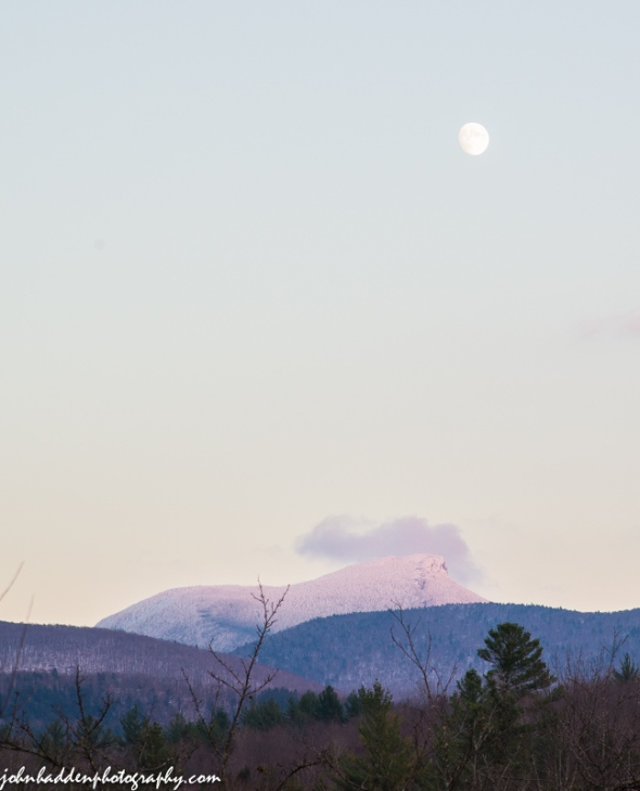 The moon rises above Camel's Hump yesterday evening.