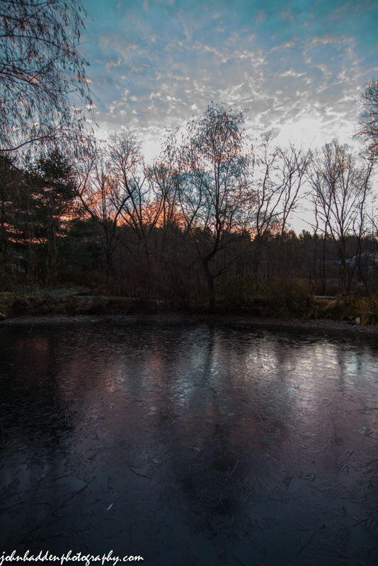 Pink clouds above our iced-over pond this morning