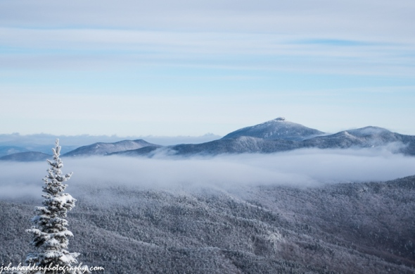Camel's Hump and low clouds front the Mad River Glen single chair