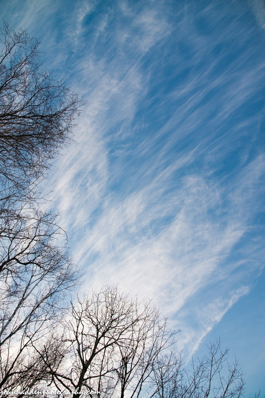 Cirrus clouds stream out of the west late Sunday afternoon