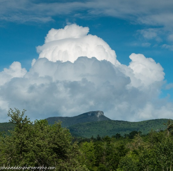 Tall cumulus clouds build above Camel's Hump
