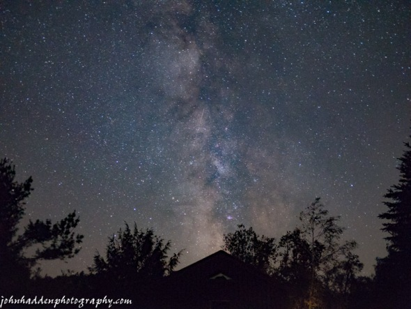The Milky Way arcs over our garage last night. Note the meteor streaking through the center of the frame!